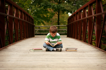 Boy on bridge reading